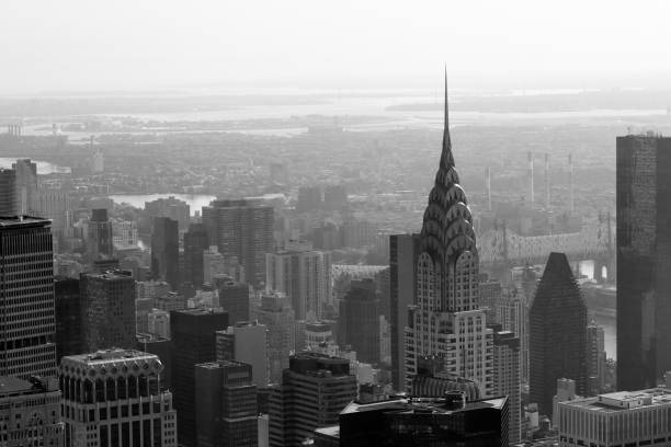 chrysler building and city skyline aerial view in black and white in new york - chrysler building stock photos and pictures