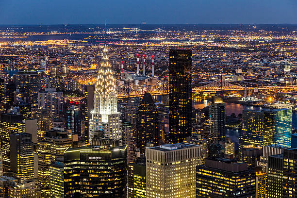 chrysler building at night  in manhattan, new york - chrysler building stock photos and pictures
