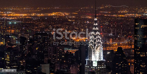 Manhattan at night, beautifully illuminated, highlighting the Chrysler Building. Picture taken from the observatory of the Empire State Building in October, 2013.
