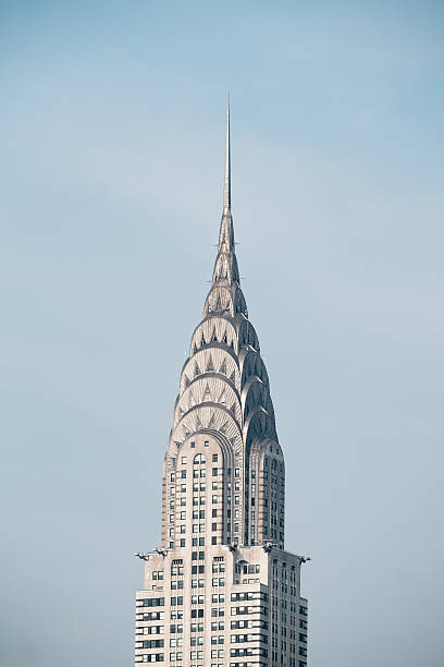 chrysler building silver metal spire - chrysler building stock photos and pictures