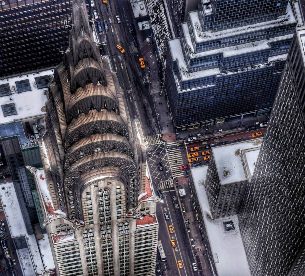 chrysler building with snow - chrysler building stock photos and pictures