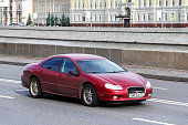Moscow, Russia - June 3, 2012: Red car Chrysler Concorde in the city street.