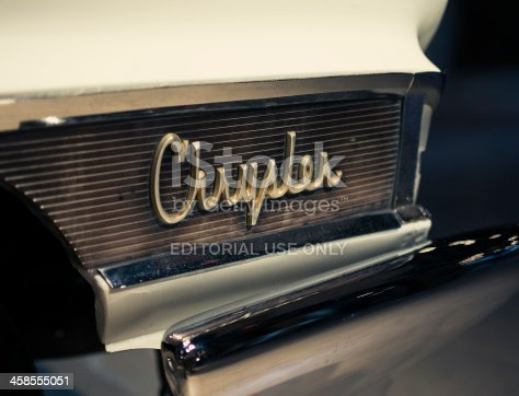 Tennessee, United States - December 26, 2011: Chrysler vintage logo close up, on the side bumper of a Model 300 from the 60s.