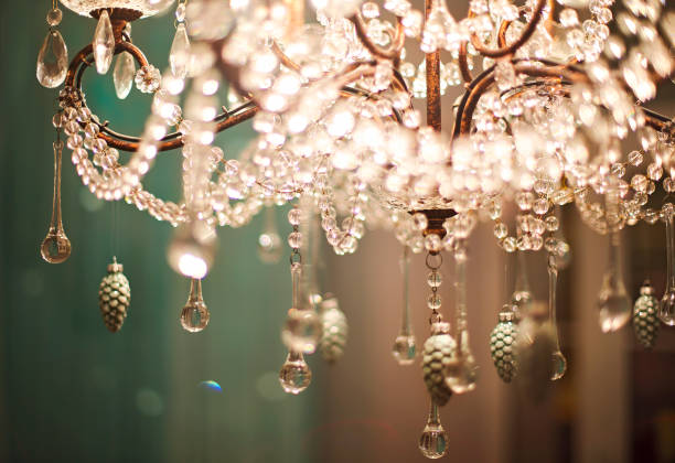 Chrystal chandelier close up Chrystal chandelier close up. Glamour background with copy space chandelier stock pictures, royalty-free photos & images