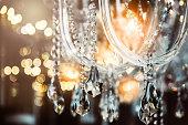 A fancy white chandelier on a black background.