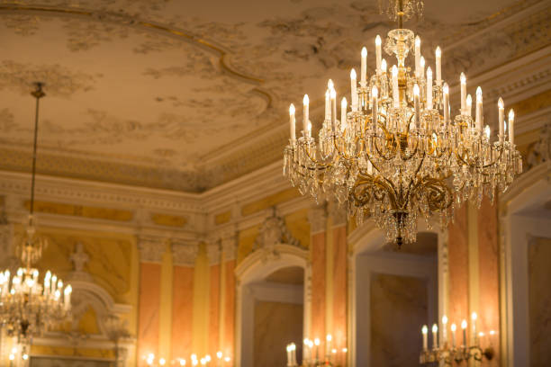 Chrystal chandelier in a splendid baroque room Chrystal chandelier in a splendid baroque room chandelier stock pictures, royalty-free photos & images