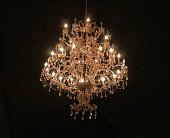 Chrystal chandelier isolated on black background.