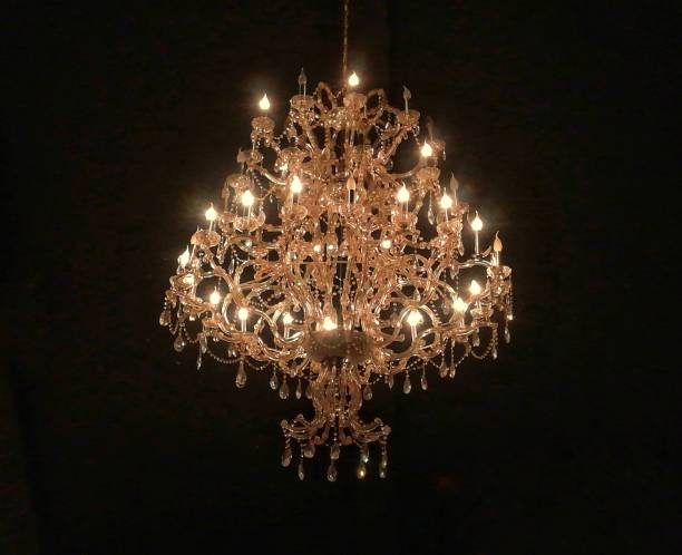 Chrystal chandelier isolated on black background Chrystal chandelier isolated on black background. chandelier stock pictures, royalty-free photos & images