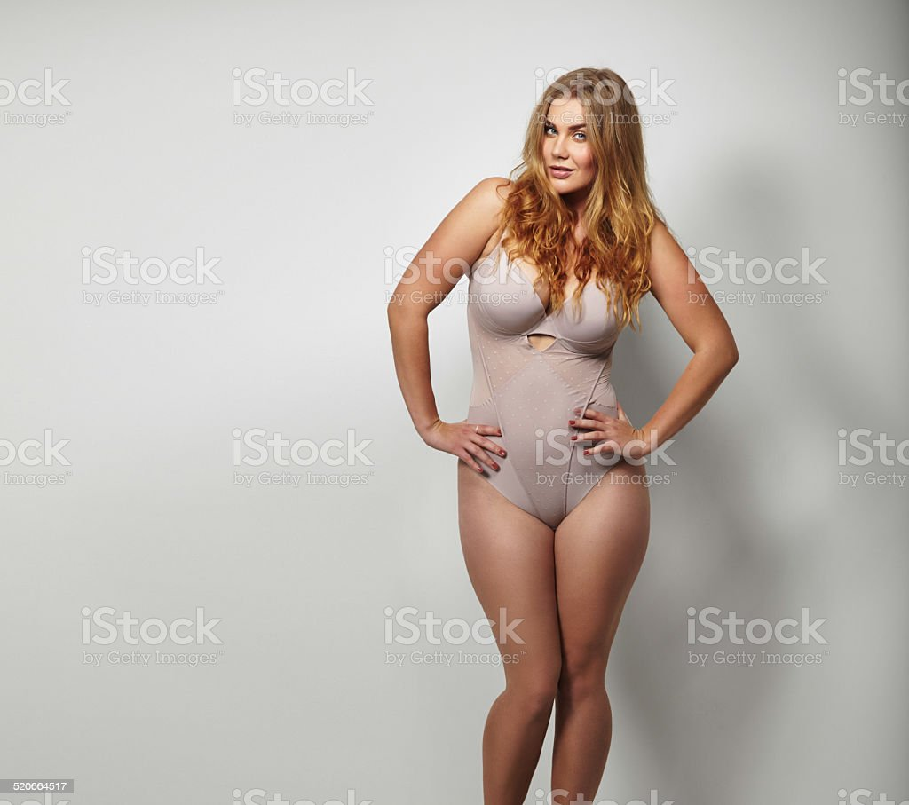 Chubby young woman in body stocking stock photo
