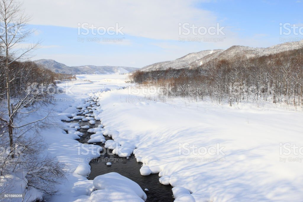 Chubetsu river in the middle of Hollaido stock photo