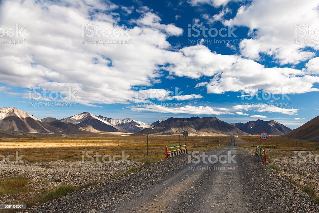Chukotka road through the tundra and hills stock photo
