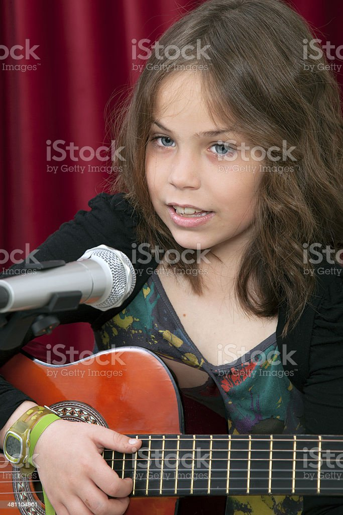 Chuld playing acoostic guitar royalty-free stock photo