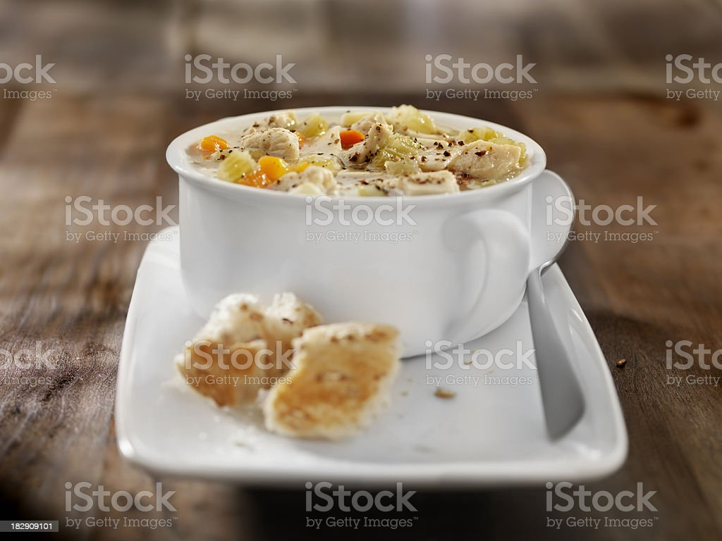 Chunky Chicken Noodle Soup with Crusty Bread royalty-free stock photo