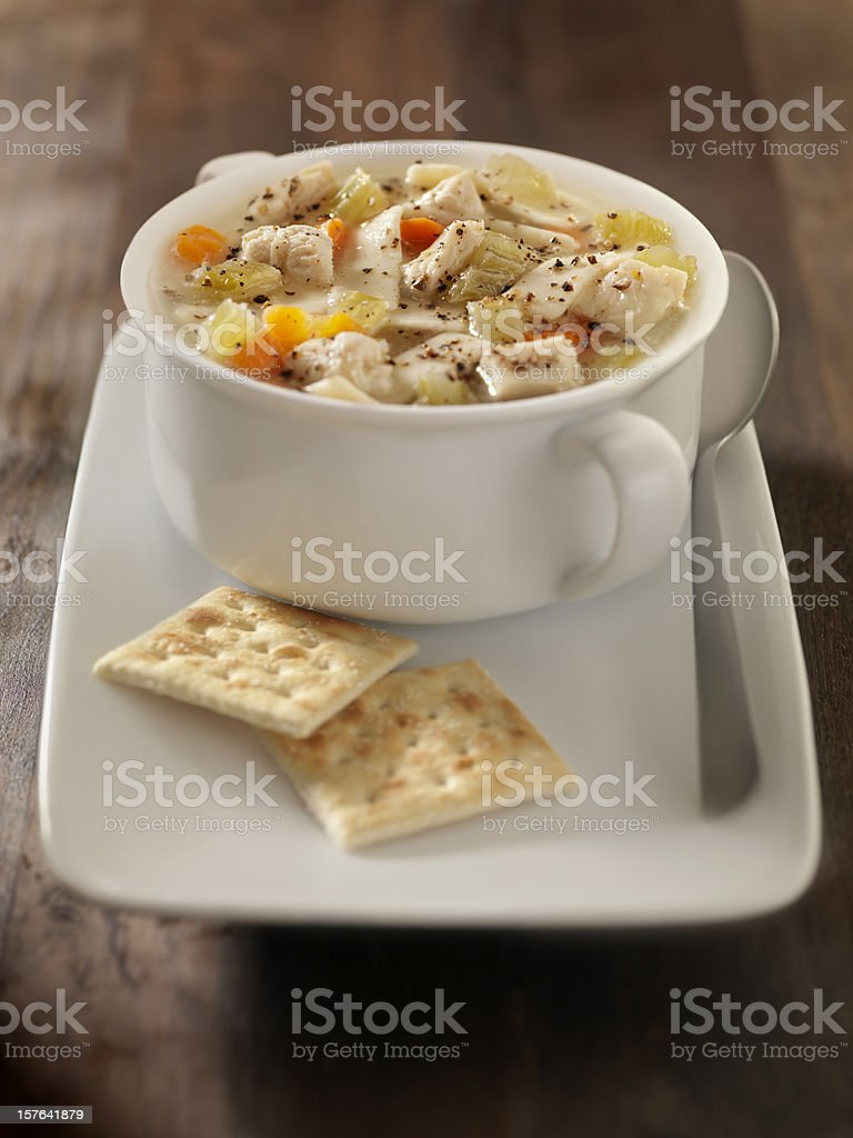 Chunky Chicken Noodle Soup with Saltine Crackers royalty-free stock photo