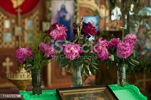 istock Church altar decorated with chrysanthemums. Interior of a village orthodox church 1144722768
