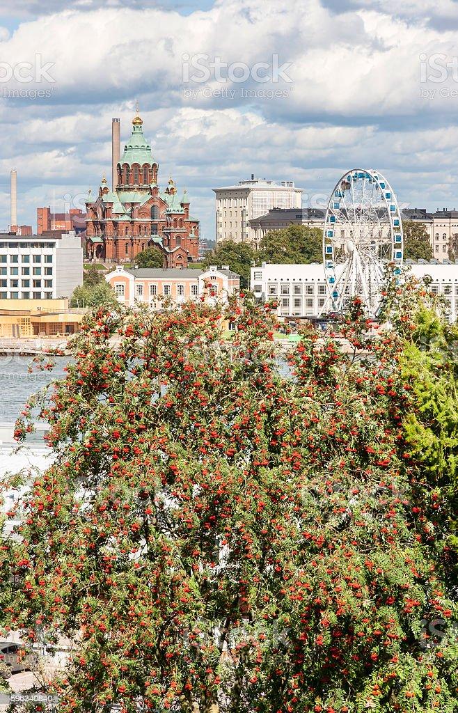 Church and a ferris wheel in Helsinki, Finland royalty-free stock photo