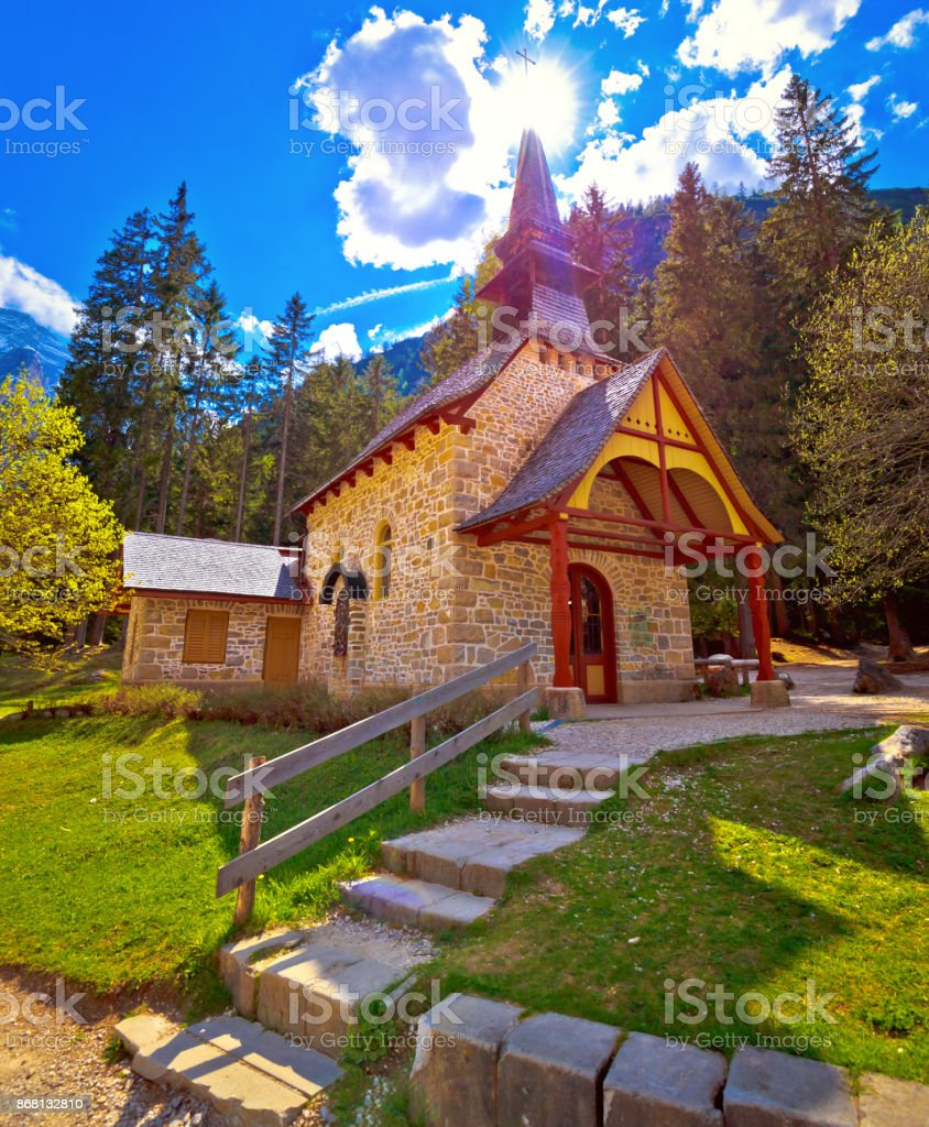 Church and Braies lake in Dolomite Apls, South Tyrol, Italy stock photo