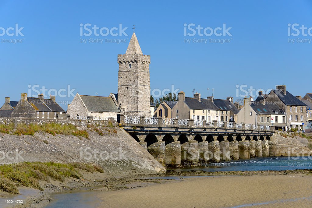 Church and bridge of Port-Bail in France stock photo