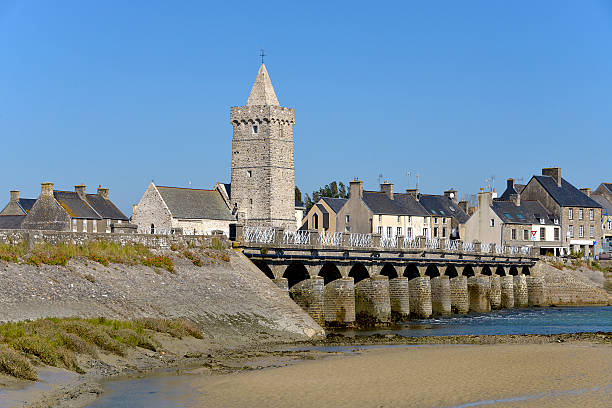 Church and bridge of Port-Bail in France Church of Notre-Dame and old bridge at Port-Bail or Porbail, a commune in the peninsula of Cotentin in the Manche department in Lower Normandy in north-western France cherbourg stock pictures, royalty-free photos & images