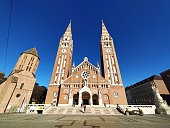Szeged, Hungary: February 1, 2020 - The Votive Church and Cathedral of Our Lady of Hungary is a twin-spired roman catholic cathedral in Szeged, Hungary. It lies on Dom Ter square beside the Domotor tower. Construction began in 1913, but due to the outbreak of the First World War, it was not completed until 1930.