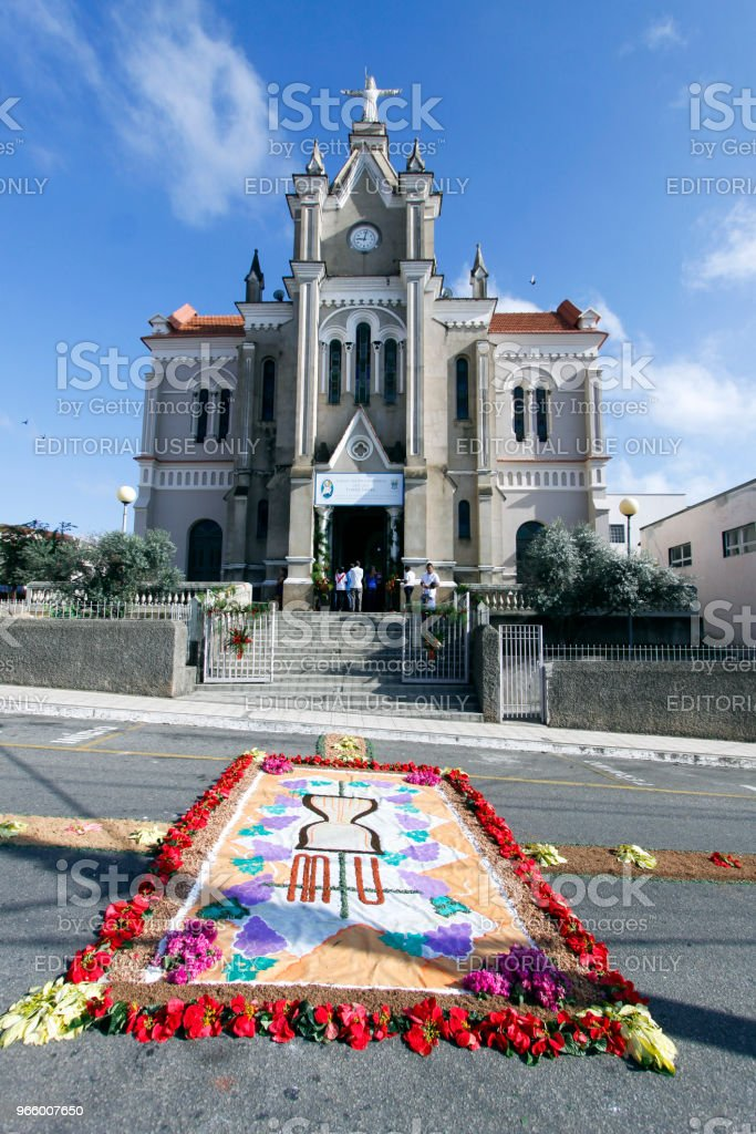Church and colorful carpet in Corpus Christi procession - Royalty-free Arrangement Stock Photo