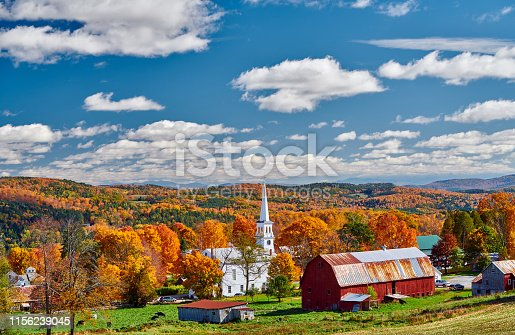 488912426istockphoto Church and farm with red barn at autumn 1156239045