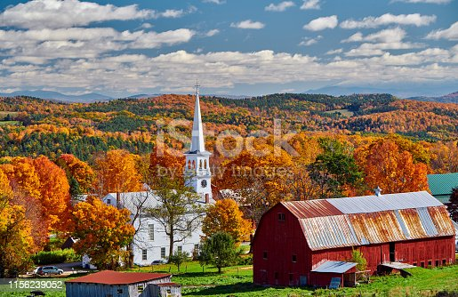 488912426istockphoto Church and farm with red barn at autumn 1156239052