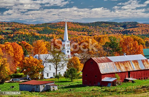 488912426istockphoto Church and farm with red barn at autumn 1156239054