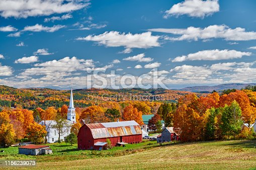 488912426istockphoto Church and farm with red barn at autumn 1156239073