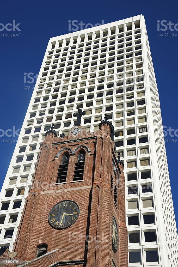 Church and modern white office tower in San Francisco stock photo