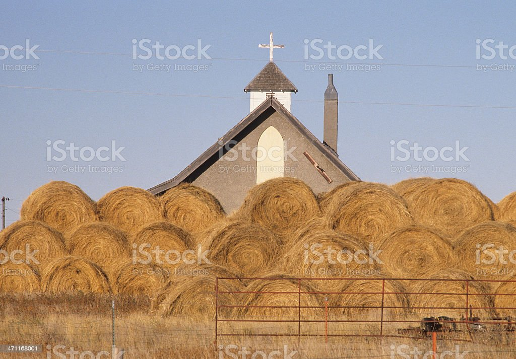 Church and rolled hay royalty-free stock photo