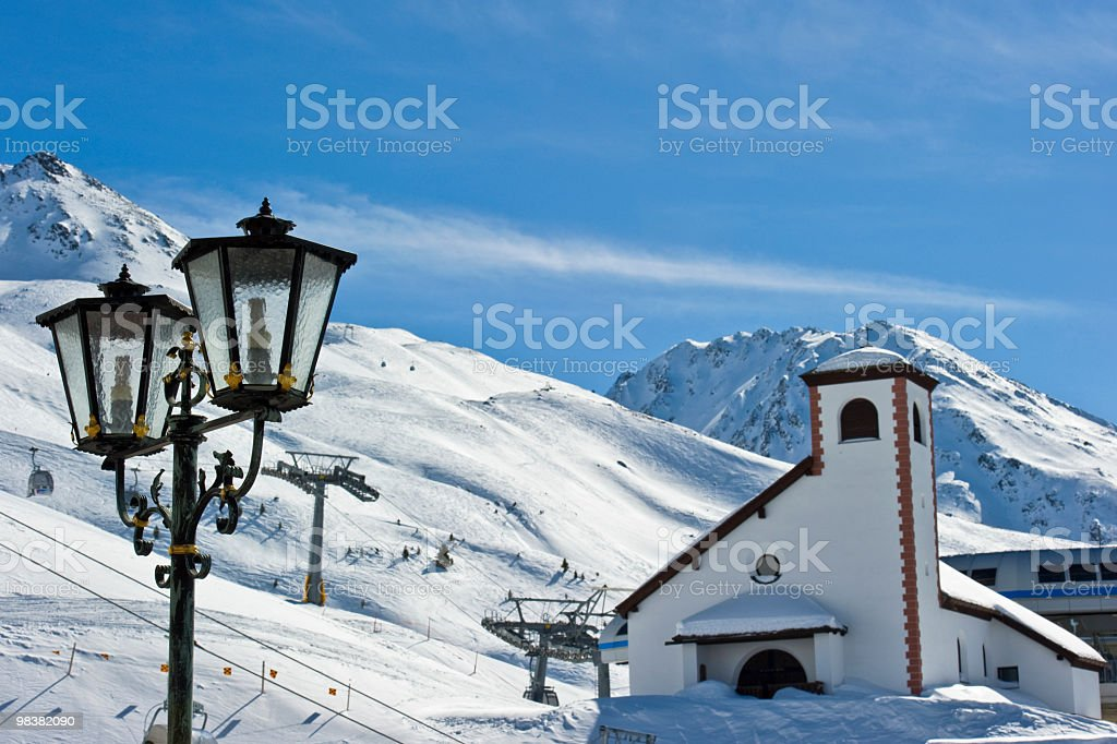 Church and Street Lamp in Obergurgl royalty-free stock photo