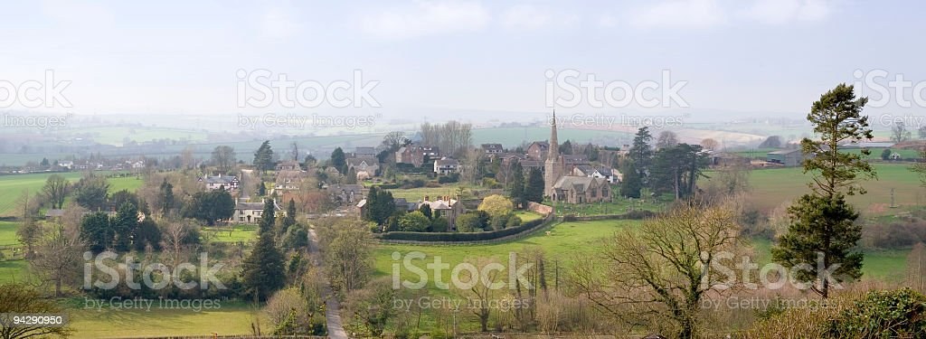 Church and village panorama stock photo