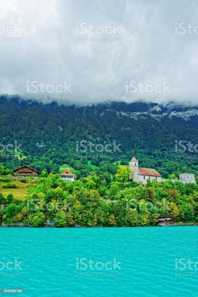 Church at Brienz Lake and Brienzer Rothorn mountain Bern Swiss stock photo