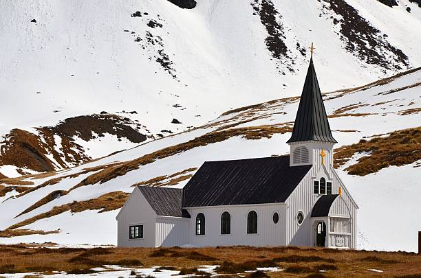 Church at Grytviken, South Georgia The recently restored Norwegian Lutheran Church was prefabricated in Norway and built in Grytviken, South Georgia in 1913 at the base of the mountains for the whalers to use for worship. south georgia island stock pictures, royalty-free photos & images