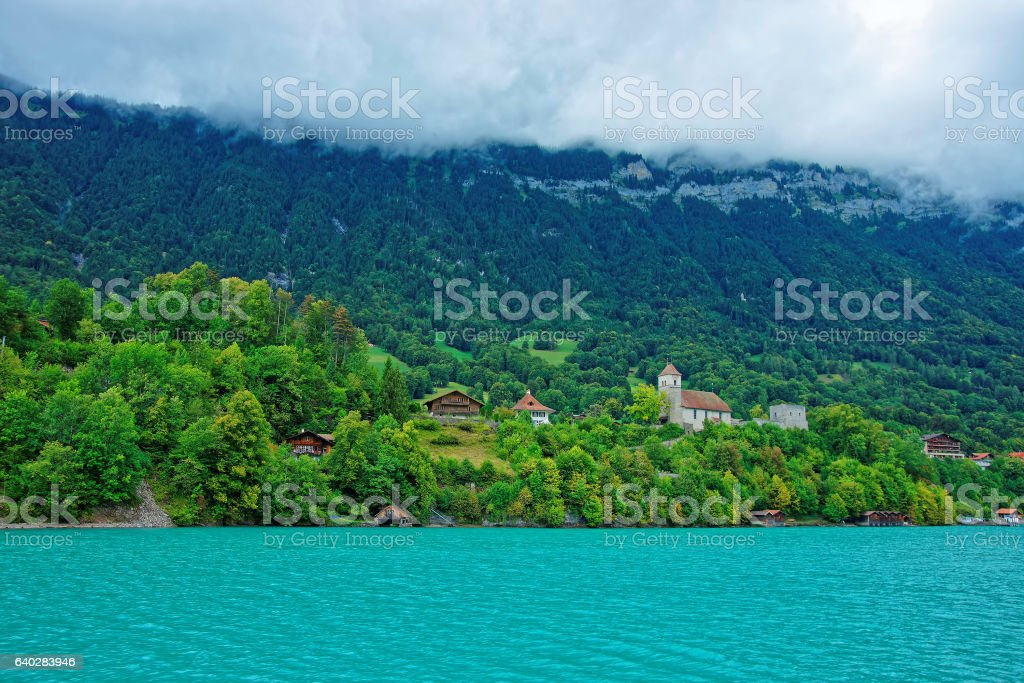 Church at Lake Brienz and Brienzer Rothorn mountain Bern Swiss stock photo