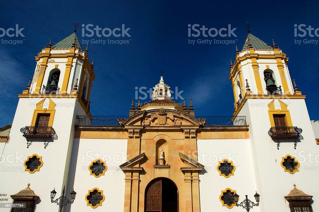 Church at sunset in Socorro plaza, square, Ronda, Andalusia, Spain stock photo