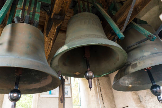Church bells Three large church bells made of copper. bell tower tower stock pictures, royalty-free photos & images
