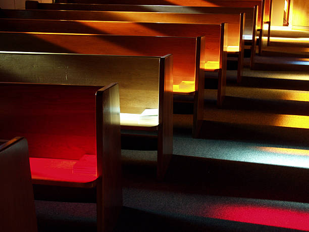 Church Benches at Sunset Shot these benches (or pews) at sunset after a friend's wedding rehearsal with an Olympus E-10 digital SLR. pew stock pictures, royalty-free photos & images
