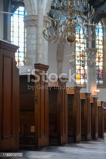 Church benches with focus in front Chandelier Stained Glass bokeh
