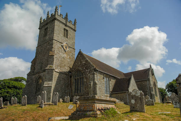 Church builidng and cemetary in Kent UK stock photo