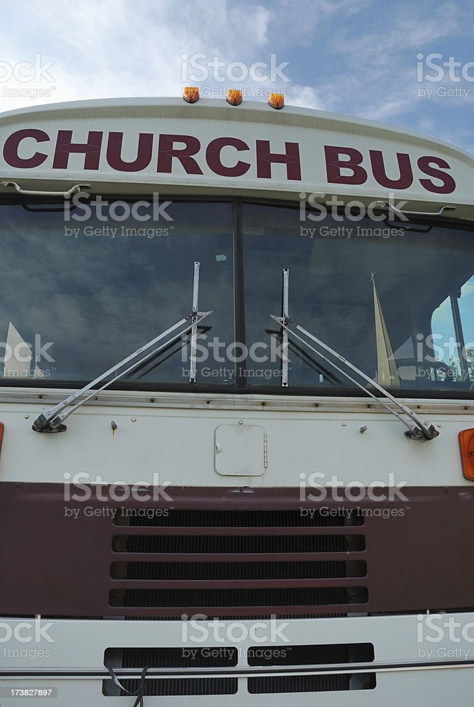 Church bus front with steeple reflection stock photo