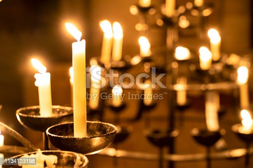 Church candles burn in the church