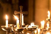 Church candles burn in the church
