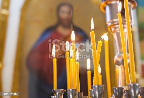 istock Church candles burn in the church 802362348