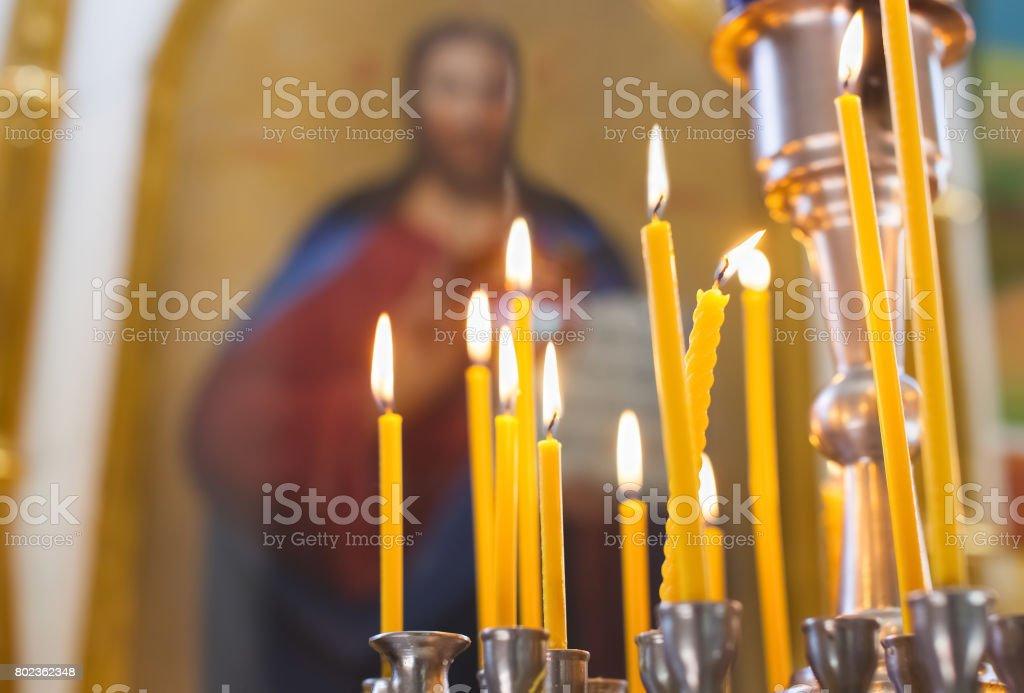 Church candles burn in the church stock photo
