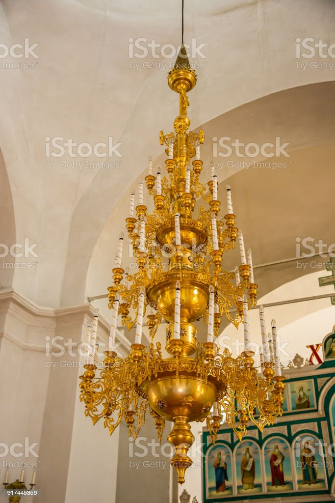 Church chandelier hanging under the dome stock photo