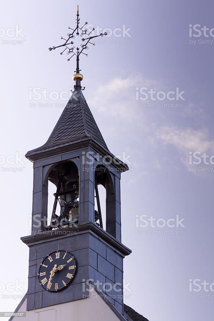 Church clock against blue sky. stock photo
