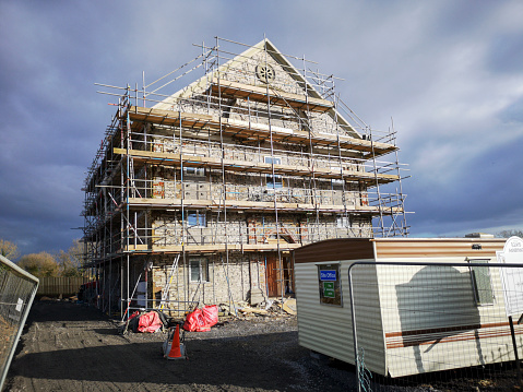 Swansea, UK: January 28, 2019: Church renovation and conversion into an apartment building containing fourteen flats. The cemetery is still in the same location and permission would have been required. A caravan is situated outside for the construction workers.