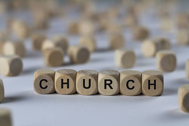 church - cube with letters, sign with wooden cubes stock photo